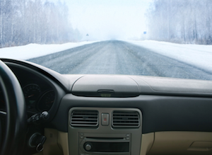 Snowy road over dashboard