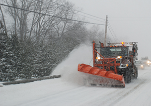 Plow on road during storm
