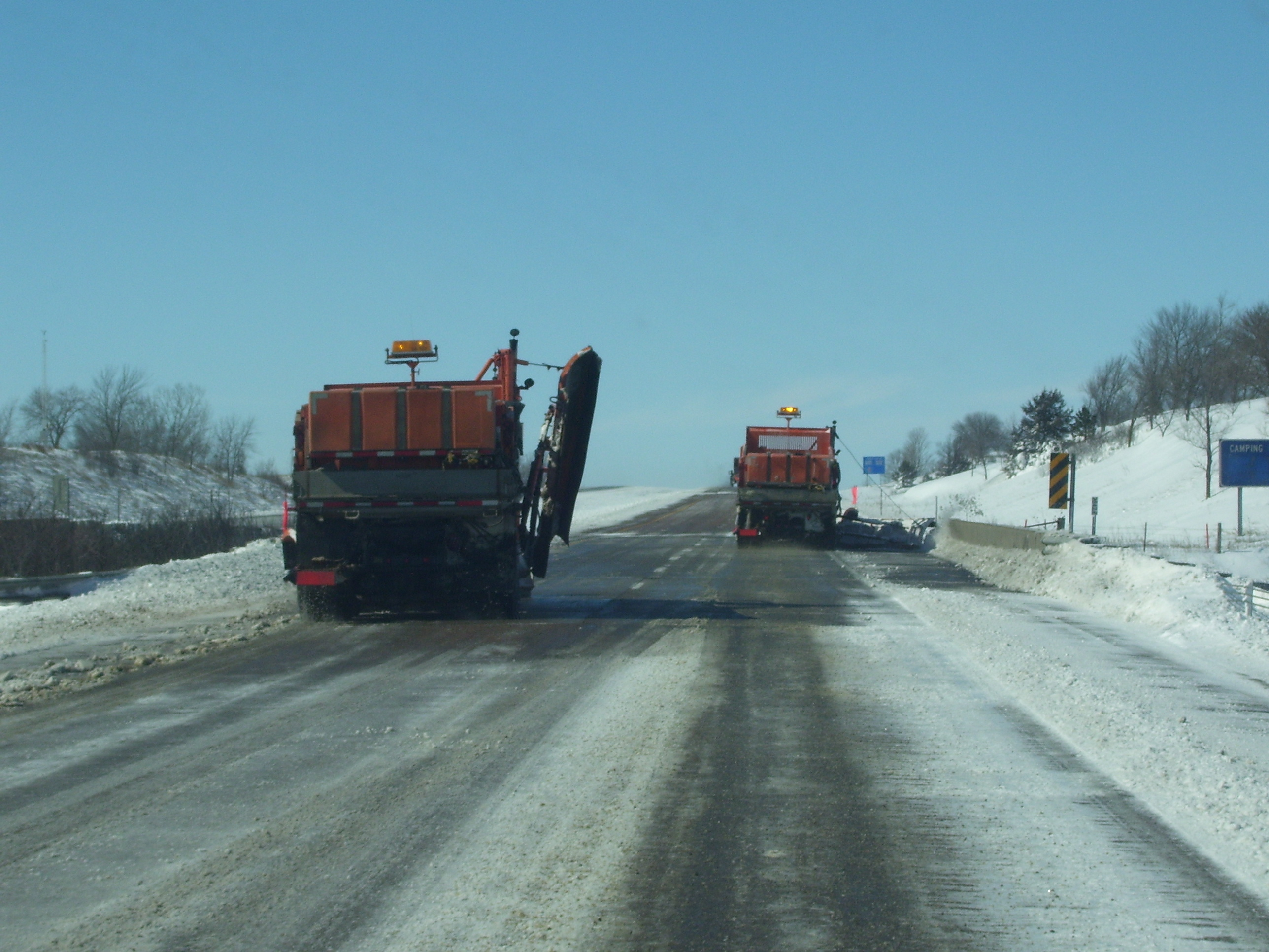 Snowplows clearing a street after a storm