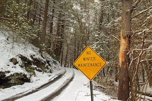 No Winter Maintenance sign on winter road